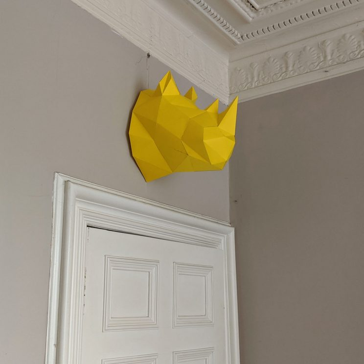 Paper rhino above our living room door