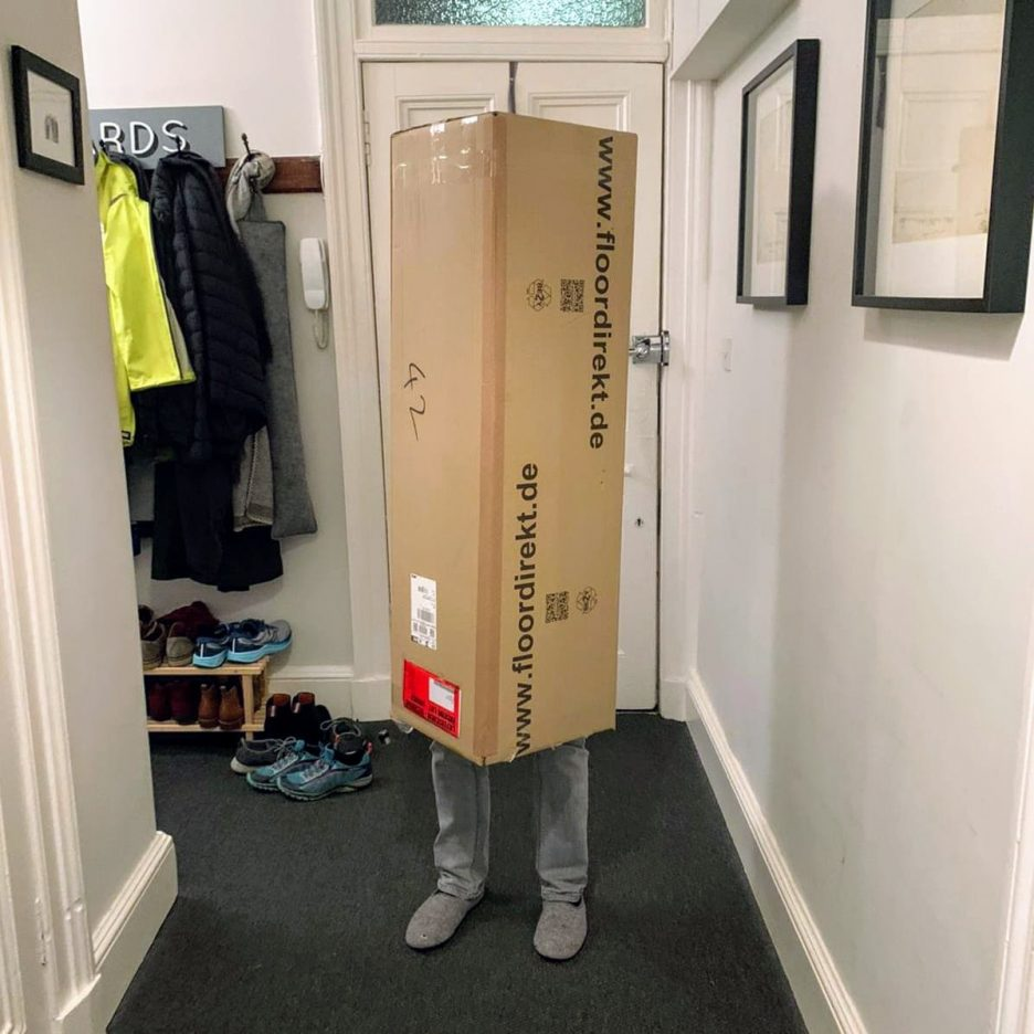 Me dressed in a long cardboard box, with only my lower legs visible