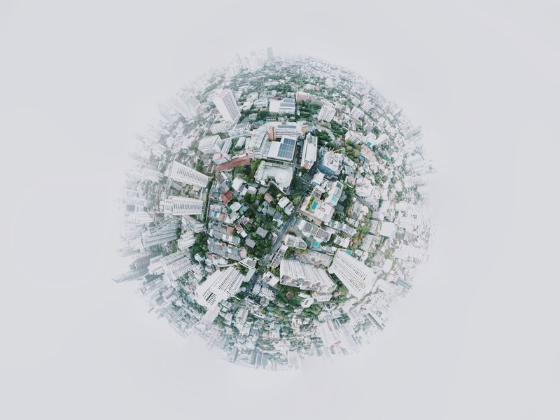 Faded out aerial view of an urban area taken on a fisheye lens