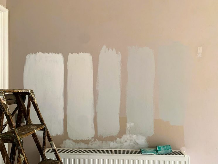 Test patches of various shades of grey paint