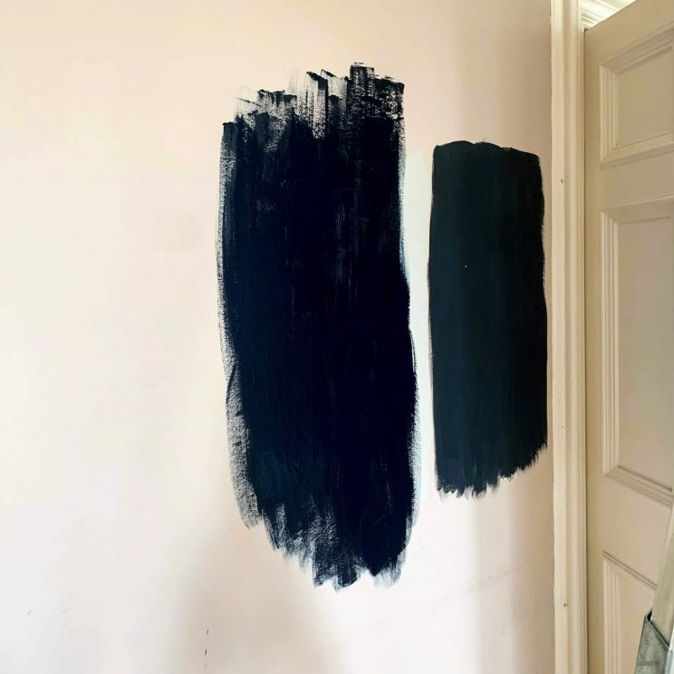 Two dark blue test patches on the wall