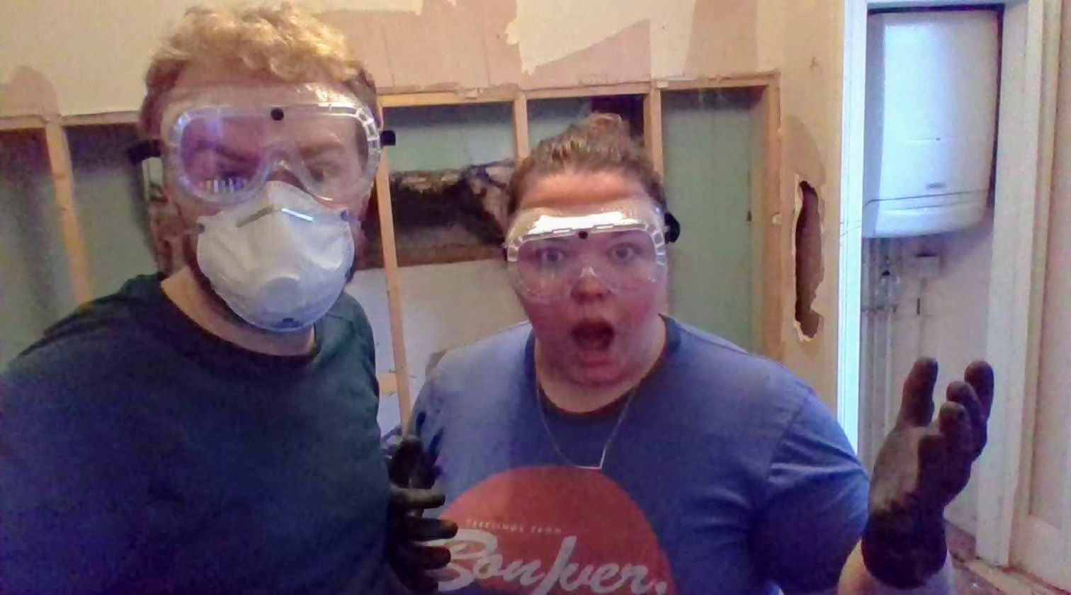 Me and Alex wearing masks while demolishing a false wall