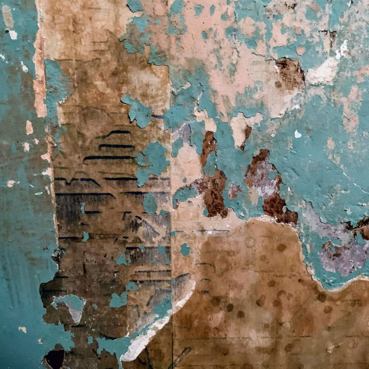 Patchwork of old wallpaper on the wall