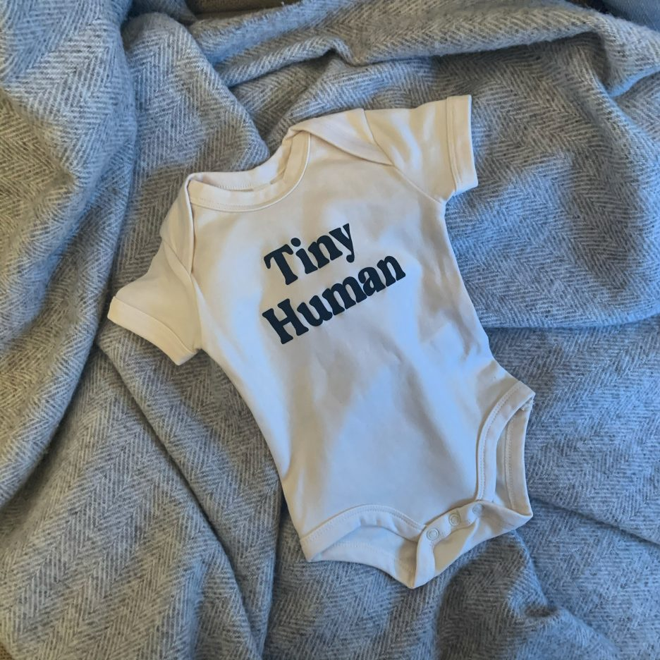 """Baby grow with """"Tiny Human"""" written on it"""