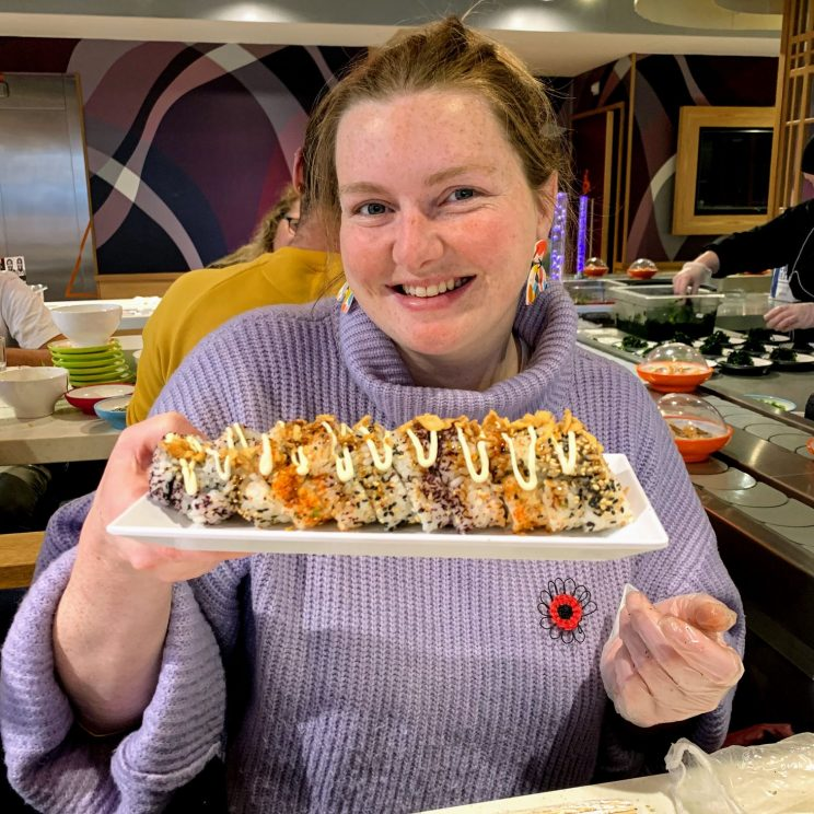 Lucy holding up her California roll