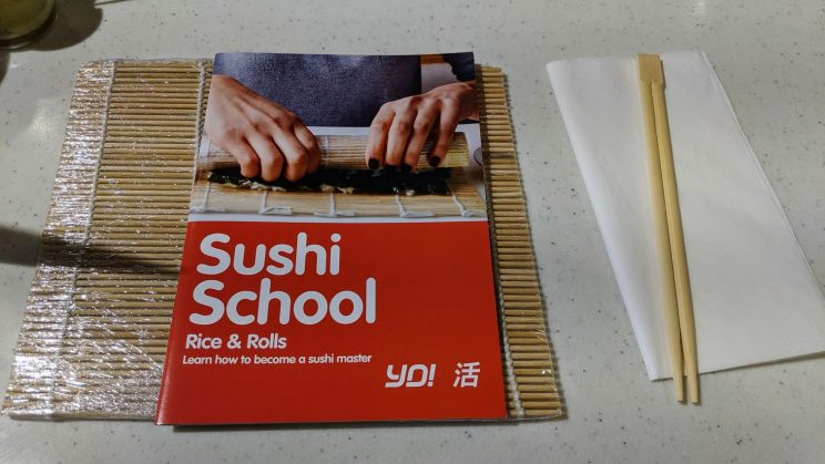 Sushi School booklet and chopsticks