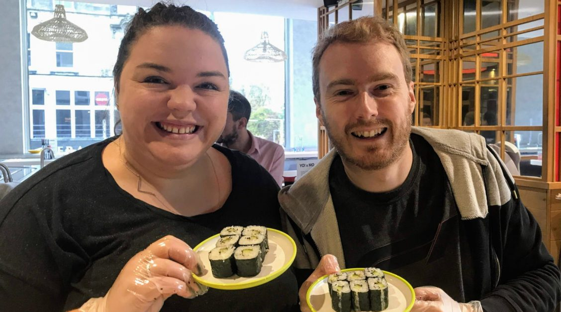 Alex and me holding up the cucumber maki we'd made